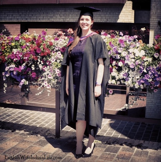 Graduation in front of flowers