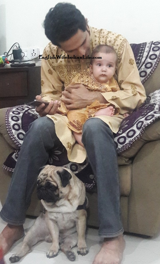 pug and baby in traditional Indian dress